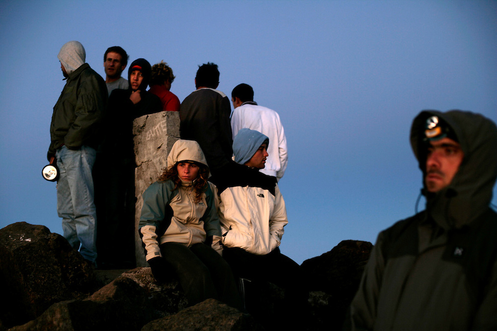 People waiting for sunrise on Pico mountain summit. Although there was 10 degree Celsius, the wind can make it look much cooler. In winter it is common to see a snow caped summit. Pico is the highest portuguese mountain with 2351m high