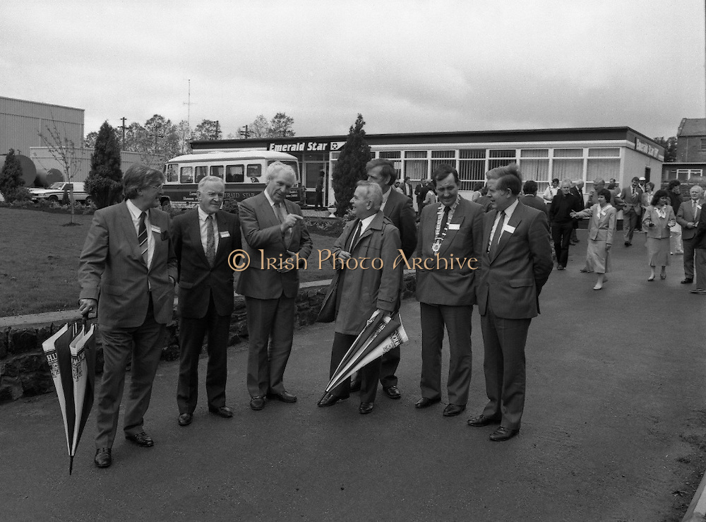 New Facilities At Emerald Star Line.   (R59)..1987..08.06.1987..06.08.1987..8th June 1987..the Minister for Transport and Tourism, Mr John Wilson TD opened a new Customer Service Facility at Emerald Star Line,Carrick on Shannon. Following the viewing of the facility and the planting of a commemorative tree, the Minister, accompanied by Mr Brian Slowey,Managing Director, Guinness,Ireland and Mr E H Bodell, Chairman, Emerald Star line departed on a cruise of The Shannon aboard an Emerald Star Cruiser...Image shows the Minister for Transport and Tourism, Mr John Wilson TD, touring the new facility in the company of;Mr E H Bodell, Chairman,Emerald Star Line, Mr Brian Slowey, Managing Director, Guinness Ireland, Mr P J Ryan, Managing Director,Emerald Star Line, Deputy John Ellis,Chairman, Leitrim Co Council and mr paddy Doyle, County Manager.