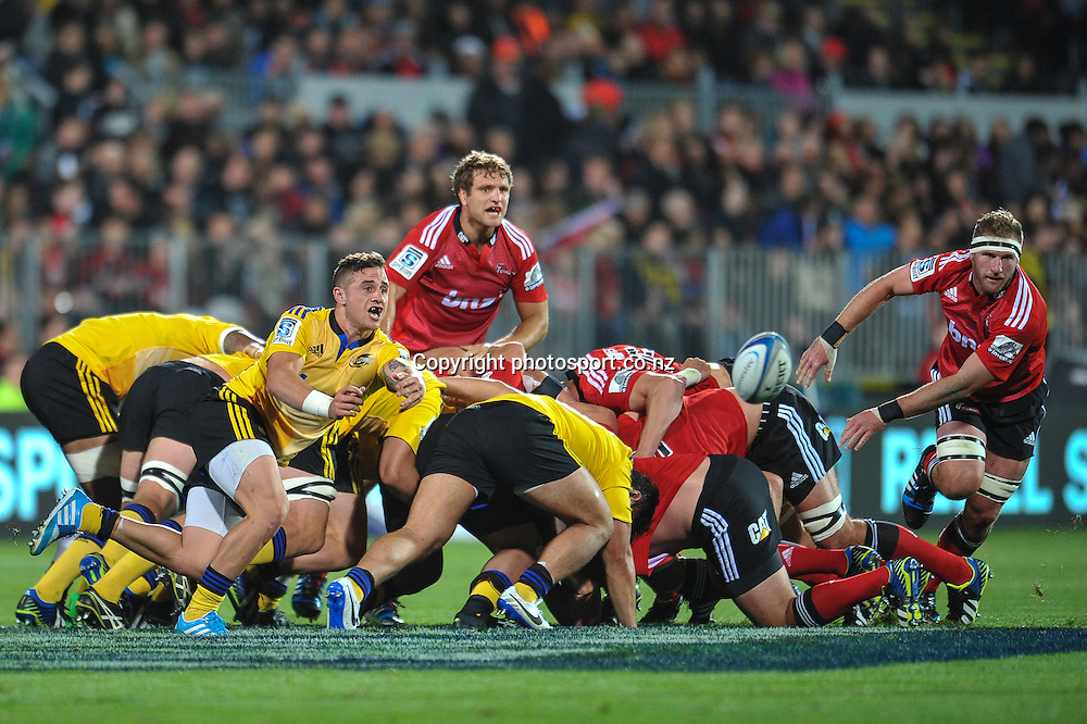 TJ Perenara of the Hurricanes passes from a scrum in the Super Rugby game, Crusaders v Hurricanes, 28 March 2014. Photo:John Davidson/photosport.co.nz