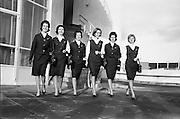 A group of Aer Lingus hostesses model their new uniform of Irish tweed. The three-piece ensemble in St Patrick's blue is worn with a sculpted beret and accessories in midnight blue. The material was designed and made by the McNutt Weaving, Downings, Co Donegal..13.12.1962