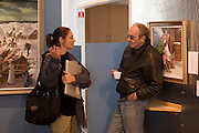 ICE.MWdrv05.12.xrw..Björn Thoroddsen, 57, called Bennie, visits with Faith D'Aluisio, wife of photographer Peter Menzel at the Maritime Museum in Reykjavik, Iceland?where his wife Margaret (Linda), works part-time. Ten years ago he, a former airline pilot, and his family were the Icelandic participants in Menzel's Material World: A Global Family Portrait, 1994 for which they took all of their possessions out of their house for a family and possessions portrait in the snow. Pages 162-163. {{Central image from original book project is: ICE.mw.01.xxs.}}.