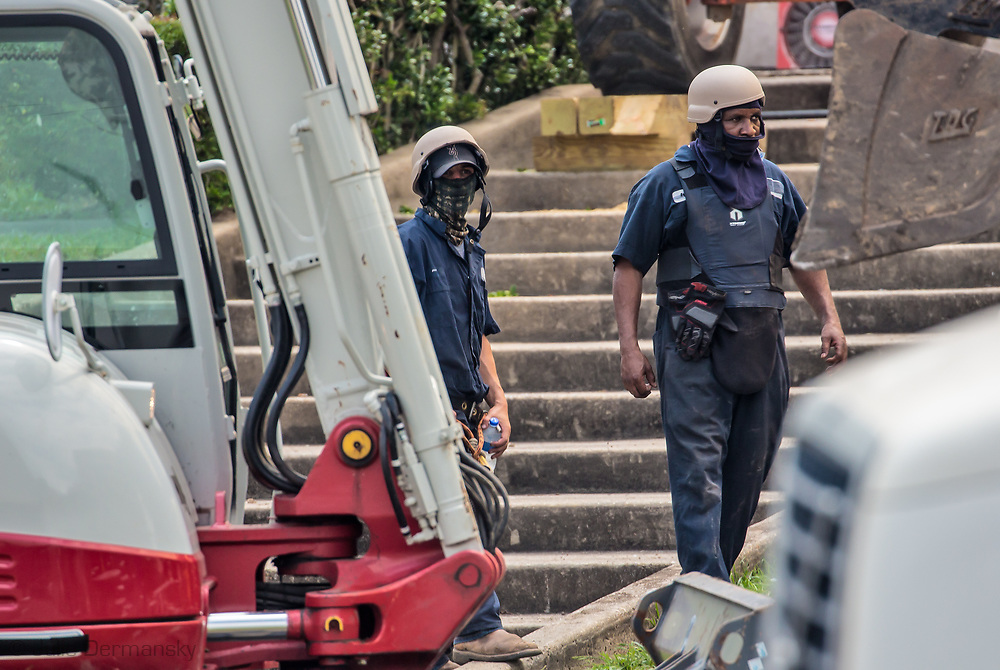 Workers tasked at removing Confederate Monuments in New Orleans cover their faces, hiding their identities after death threats were made to companies that put in bids for the job.