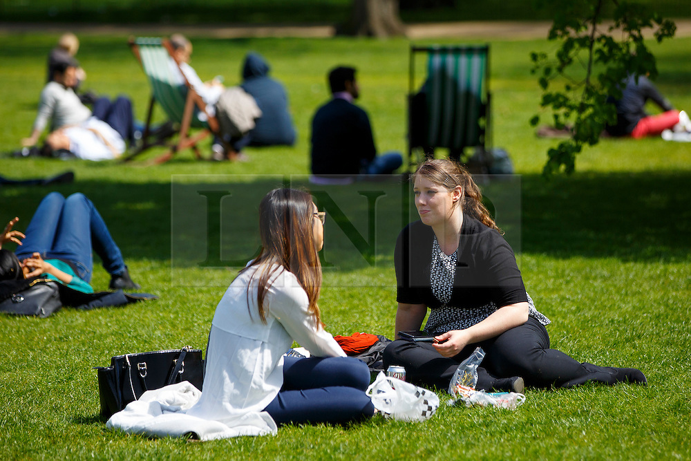© Licensed to London News Pictures. 04/05/2016. London, UK. People enjoying sunshine and warm weather in St James's Park, London on Wednesday, 4 May 2016. Photo credit: Tolga Akmen/LNP