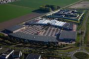 Nederland, Flevoland, Lelystad, 08-09-2009. Woonboulevard Palazzo Lelystad, winkelcentrum en bedrijventrrein, onder ander Gamma, Paraxis. Op het tweede plan  .de hightech gevangenis (onderdeel Penitentiaire Inrichting (PI) Flevoland).toeslag); aerial photo (additional fee required); .foto Siebe Swart / photo Siebe Swart