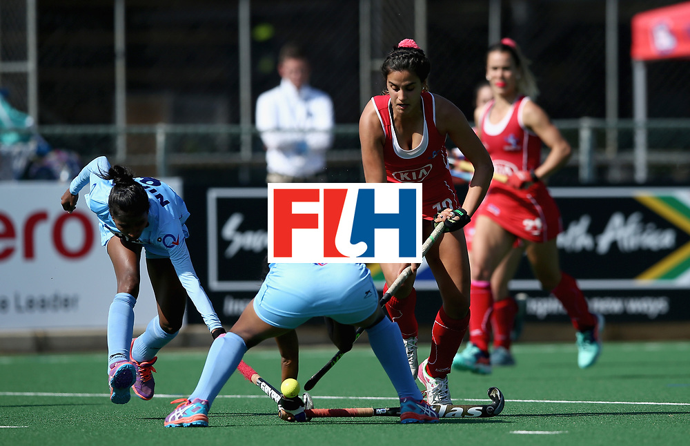 JOHANNESBURG, SOUTH AFRICA - JULY 12: Manuela Urroz of Chile and Nikki Pradhan of India battle for possession during day 3 of the FIH Hockey World League Semi Finals Pool B match between India and Chile at Wits University on July 12, 2017 in Johannesburg, South Africa. (Photo by Jan Kruger/Getty Images for FIH)