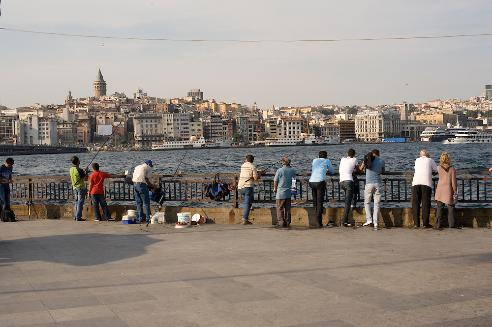 Balik ekmek (fish sandwich) and Efes beer on Galata Bridge w