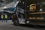 London, England, UK, September 7 2018 - An electric vehicule is charging during early morning loading of all the trucks at UPS central London site in Kentish Town.<br /> A UPS led consortium with UK Power Networks Services and Cross River Partnership has deployed a new charging technology in London that overcomes the challenge of simultaneously recharging an entire fleet of electric vehicles (EVs) without the need for the expensive upgrade to the power supply grid. The technology, based on the use of onsite energy storage batteries, is now used to provide extra energy needed during peak hours, but it should also allow to increase the number of EVs operating from UPS central London site from the current limit of 65 to all 170 trucks based there.