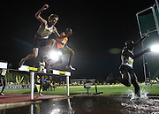 STELLENBOSCH, SOUTH AFRICA, Tuesday 20 March 2012, Dean Brummer hurdles the water jump in the mens 3000m steeplechase  during the Yellow Pages Series athletics meeting at the University of Stellenbosch Coetzenburg stadium..Photo by Roger Sedres/Image SA