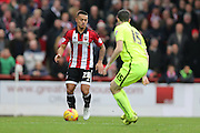 Brentford defender Nico Yennaris during the Sky Bet Championship match between Brentford and Brighton and Hove Albion at Griffin Park, London, England on 26 December 2015.