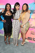 "Los Angeles, CA-June 29:  (L-R) Tina Douglas, Recording Artist/Actress Ashanti Shequoiya Douglas and her sister Kenashia Douglas attend the Seventh Annual "" Pre "" Dinner celebrating BET Awards hosted by BET Network/CEO Debra L. Lee held at Miulk Studios on June 29, 2013 in Los Angeles, CA. © Terrence Jennings"