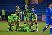 Forest Green Rovers players appear concerned as Udoka Godwin-Malife (#22) of Forest Green Rovers lies on the turf with a head injury during the The FA Cup match between Carlisle United and Forest Green Rovers at Brunton Park, Carlisle, England on 10 December 2019.