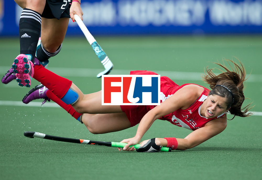 Hockey World Cup 2014<br /> The Hague, Netherlands <br /> Day 4 Women USA v Argentina<br /> Katie Reinprecht has a shot at goal<br /> Photo: Grant Treeby<br /> www.treebyimages.com.au