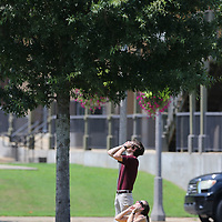 Landon Kennedy and his wife, Gwen, gaze at the solar ecilpse at Fairpark in Tupelo on Monday.