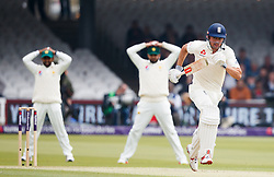 England's Alastair Cook runs between the wicket during day one of the First NatWest Test Series match at Lord's, London.