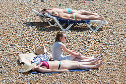 © Licensed to London News Pictures. 27/08/2017. Brighton, UK. Members of the public take to the beach in Brighton and Hove on the August Bank holiday Sunday. Photo credit: Hugo Michiels/LNP