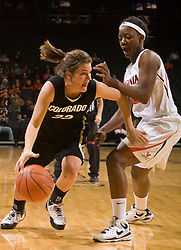 Colorado guard Kelly Jo Mullaney (32) dribbles past Virginia guard Enonge Stovall (40).  The #16 ranked Virginia Cavaliers women's basketball team defeated the Colorado Buffaloes 77-43 at the John Paul Jones Arena on the Grounds of the University of Virginia in Charlottesville, VA on November 24, 2008.