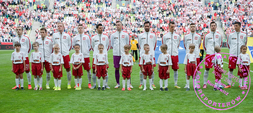 (L-R) Kamil Grosicki and Maciej Rybus and Kamil Glik and Lukasz Piszczek and Grzegorz Wojtkowiak and goalkeeper Artur Boruc and Maciej Wilusz and Arkadiusz Milik and Mateusz Klich and Grzegorz Krychowiak and Robert Lewandowski all from Poland while national anthems before international friendly match between Poland and Lithuania at PGE Arena in Gdansk, Poland.<br /> <br /> Poland, Gdansk, June 06, 2014<br /> <br /> Picture also available in RAW (NEF) or TIFF format on special request.<br /> <br /> For editorial use only. Any commercial or promotional use requires permission.<br /> <br /> Mandatory credit:<br /> Photo by &copy; Adam Nurkiewicz / Mediasport