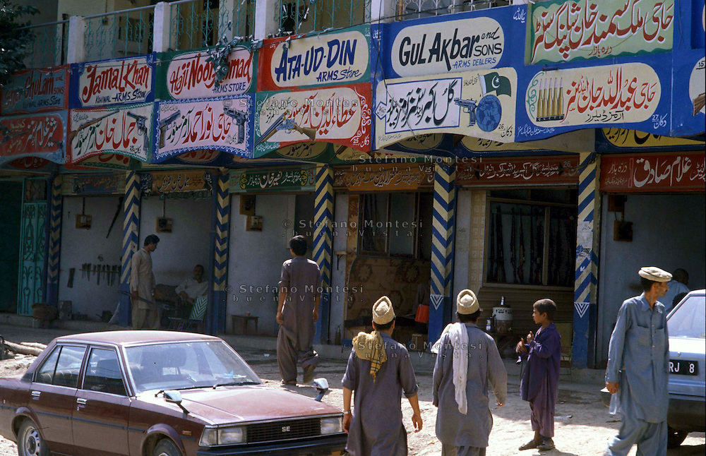 Pakistan   1986..A  street of darra with the shops of weapons..Darra Adamkhel is Pakistan's largest weapons bazaar and factory, renowned for its gun making expertise since the late 19th century, Darra is a sprawl of hundreds of workshops where some 3,500 gunsmiths toil on replica weapons.