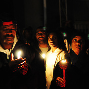 Tuesday, November 17, 2009 (Kriston J. Bethel / Staff Photographer).6100 block of Upland Ave.; Vigil for Tara Brooks, who was shot and killed this morning; g1forHomeIn.Robert Davenport, left, and friend Robin, right, hold candles at a vigil for Tara Brooks who was shot and killed early Tuesday morning.