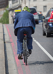 © Licensed to London News Pictures. 09/05/2016. London, UK. Former London Mayor Boris Johnson crosses Lambeth Bridge by bike after campaigning for Vote Leave ahead of the EU referendum vote on June 23rd. Photo credit: Peter Macdiarmid/LNP