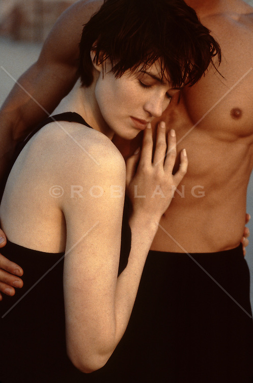 woman resting on a shirtless man's chest