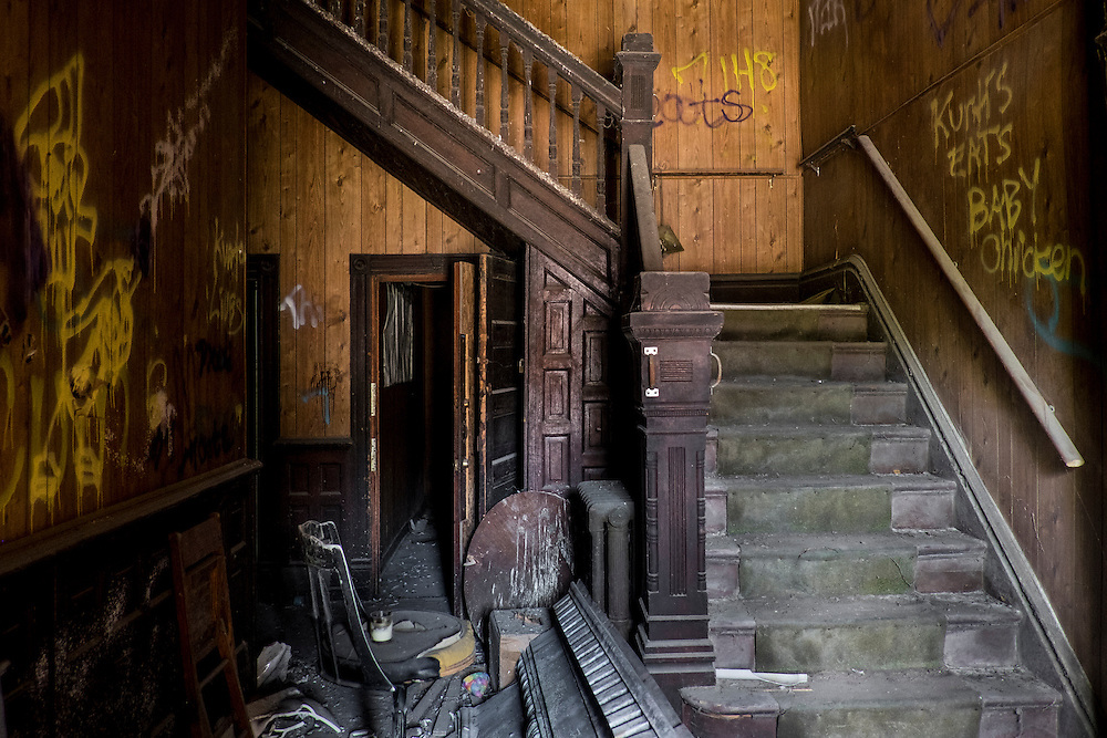 Stairway inside the Fifth Avenue Hotel in Monessen, PA. The abandond hotel has been declared a public safety hazard and must be demolished. Mayor Lou Mavrakis said it is estimaged it will cost more than $100,000 to demolish the building with is owned by a New York man who owes $53,000 in back real estate taxes on the property.<br /> <br /> In Monessen's heyday in the 1930's the town had 25 hotels. The only one still standing is the Fifth Avenue Hotel.<br /> <br /> Monessen, a third-class city, faces the same problems as th other former steel towns &mdash; declining population and tax revenue after the mills shut down. The city's population has dropped to 7,600 from a high of 20,268 in 1930.