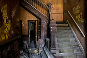 Stairway inside the Fifth Avenue Hotel in Monessen, PA. The abandond hotel has been declared a public safety hazard and must be demolished. Mayor Lou Mavrakis said it is estimaged it will cost more than $100,000 to demolish the building with is owned by a New York man who owes $53,000 in back real estate taxes on the property.<br /> <br /> In Monessen's heyday in the 1930's the town had 25 hotels. The only one still standing is the Fifth Avenue Hotel.<br /> <br /> Monessen, a third-class city, faces the same problems as th other former steel towns — declining population and tax revenue after the mills shut down. The city's population has dropped to 7,600 from a high of 20,268 in 1930.