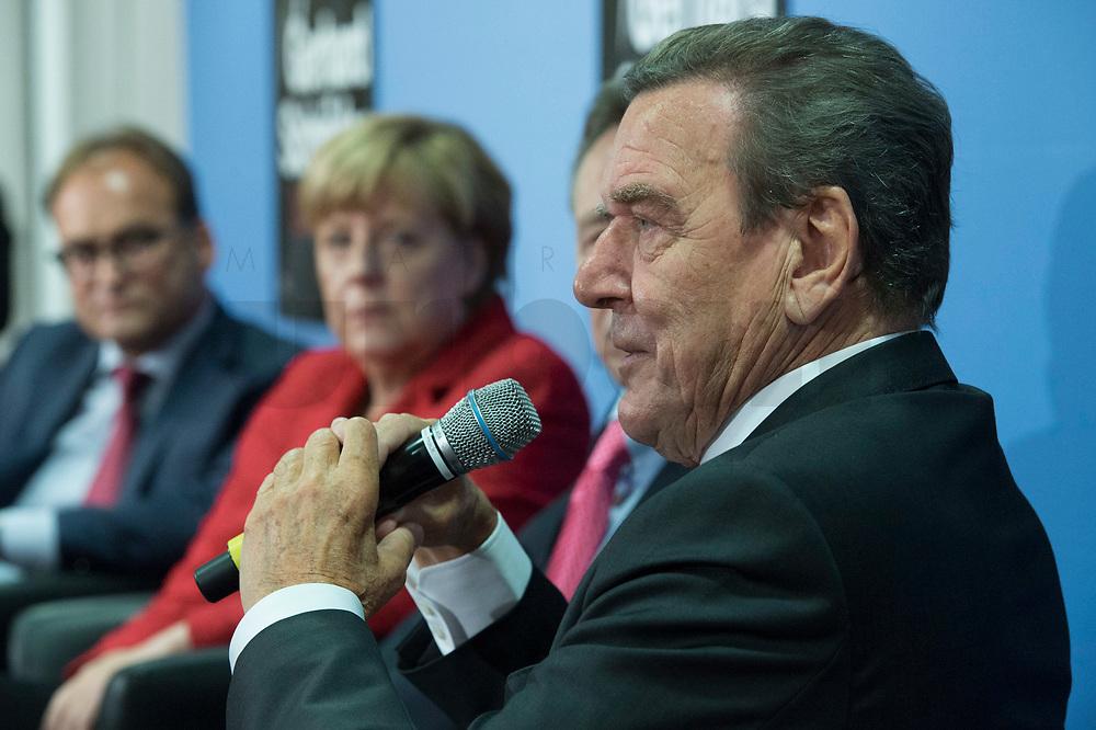 """22 SEP 2015, BERLIN/GERMANY:<br /> Gerhard Schroeder (R), SPD, Bundeskanzler a.D., und Angela Merkel (M), CDU, Bundeskanzlerin, waehrend der Vorstellung des Buches """"Gerhard Schroeder - Die Biographie"""", Tagungszentrum Bundespressekonferenz<br /> IMAGE: 20150922-01-030<br /> KEYWORDS: Buchvorstellung, Gerhard Schröder"""