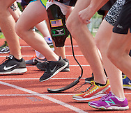 West Point, New York - Athletes, including one with a running blade, line up for the start of the 1,500-meter run in the 2014 Army Warrior Trials at the United States Military Academy Preparatory School on Tuesday, June 17, 2014.<br />