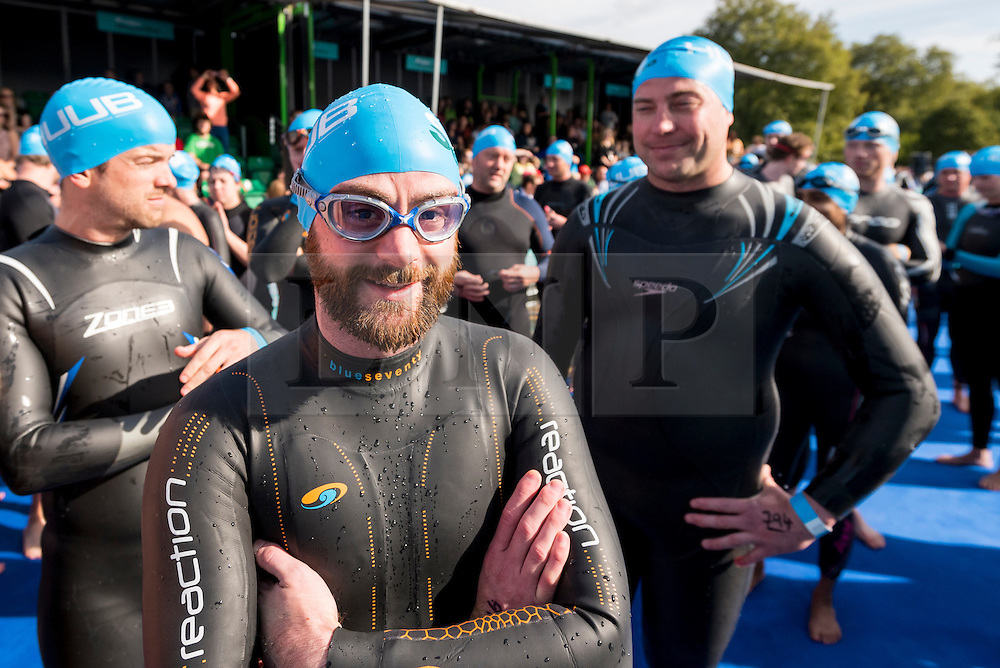 © Licensed to London News Pictures. 24/09/2016. London, UK. Participants take part in the first ever Swim Serpentine, held in the famous lake in Hyde Park.  Raising thousands for charity and with water temperatures of 18C, swimmers navigate the one mile clockwise route around the lake.  The two-day open water swimming festival includes the British Open Water Swimming Championships on Sunday. Photo credit : Stephen Chung/LNP
