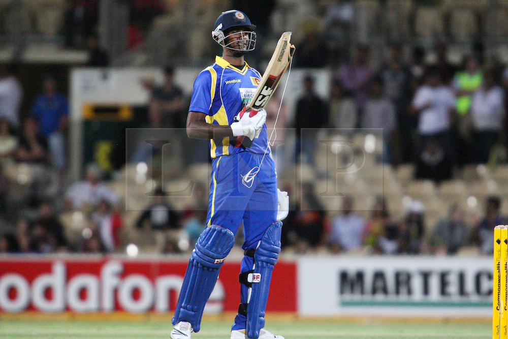 © Licensed to London News Pictures. 08/03/2012. Adelaide Oval, Australia. Farveez Maharoof looks at his bat after it breaks during the One Day International cricket match final between Australia Vs Sri Lanka. Photo credit : Asanka Brendon Ratnayake/LNP