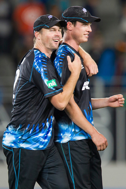 New Zealand's Adam Milne and Colin Munro celebrate defeating the West Indies  in the Twenty-20 International Cricket Match, Eden Park, Auckland, New Zealand, Saturday, January 11, 2014. Credit: SNPA/David Rowland