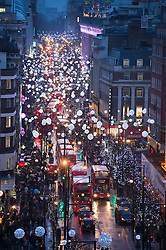 © London News Pictures. 23/12/2013 . London, UK.  An aerial view of over shoppers on Oxford Street covered in festive Christmas. London's most popular retail district is experiencing is busiest time of the year leading up to Christmas day on Wednesday. Photo credit : Ben Cawthra/LNP