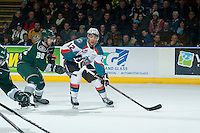 KELOWNA, CANADA - JANUARY 24: Kevin Davis #38 of Everett Silvertips back checks Tyrell Goulbourne #12 of Kelowna Rockets on January 24, 2015 at Prospera Place in Kelowna, British Columbia, Canada.  (Photo by Marissa Baecker/Shoot the Breeze)  *** Local Caption *** Kevin Davis; Tyrell Goulbourne;
