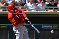 MESA, AZ - MARCH 09:  Eugenio Suarez #7 of the Cincinnati Reds singles in the second inning against the Oakland Athletics in the spring training game at HoHoKam Stadium on March 9, 2017 in Mesa, Arizona.  (Photo by Jennifer Stewart/Getty Images)