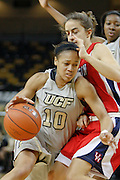 January 27, 2011: Central Florida guard Aisha Patrick (10) drive the paint on Houston guard Roxana Button (22) during first half womens Conference USA NCAA basketball game action between the Houston Cougars and the Central Florida Knights at the UCF Arena Orlando, Fl.