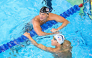 Omaha, Nebraska --<br /> <br /> Michael Phelps and Ryan Lochte shakes hands while waiting for the results of the men's 200 individual medley during the U.S. Olympic Swim Trials at the CenturyLink Center on Friday, July 1, 2016, in Omaha.<br /> <br /> MATT DIXON/THE WORLD-HERALD