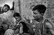 ADG (3): A group of drag addicts taking injecting drugs in open view of the public of a pedestrian overpass in Dhaka near the dhaka Medical College Hospital. June 2008 &copy; Monirul Alam<br /> <br /> A Deadly Game | Moniul Alam<br /> <br /> No one can help me, so I don&rsquo;t have any other way except begging. I leave on the street and everyday earn taka 30/40. I am also taking drugs for frustrating my life hood.<br /> &nbsp;&nbsp;&nbsp;&nbsp;&nbsp;&nbsp;&nbsp;&nbsp;&nbsp;&nbsp;&nbsp;&nbsp;&nbsp;&nbsp;&nbsp;&nbsp;&nbsp;&nbsp;&nbsp;&nbsp;&nbsp;&nbsp;&nbsp;&nbsp;&nbsp;&nbsp;&nbsp;&nbsp;&nbsp;&nbsp;&nbsp;&nbsp;&nbsp;&nbsp;&nbsp;&nbsp;&nbsp;&nbsp;&nbsp;&nbsp;&nbsp;&nbsp;&nbsp;&nbsp;&nbsp;&nbsp;&nbsp;&nbsp;&nbsp;&nbsp;&nbsp;&nbsp;&nbsp;&nbsp;&nbsp;&nbsp;&nbsp;&nbsp;                      &nbsp;-Zahid, a street bagger &amp; drug user<br /> A lame man is walking on the street at night. His name is Zahid who lost his left leg by suffering typhoid since his childhoods he said, after years he came to Dhaka from his village Bagura north part of Bangladesh and start begging for surviving. He said no one can help me, so I don&rsquo;t have any other way except begging. I leave on the street and everyday earn taka 30/40. I am also taking drugs for frustrating my life hood. Some time the police pick me up from the street and release outskirts of Dhaka. We suffer a lot but no one can help us for a good job or rehabilitations. Like Zahid, many number of people who where suffering inhuman life and every day violating their human rights. Particularly women and girls is a grave violation of human rights. It can include physical, sexual, psychological and economic abuse, which cuts across boundaries of age, race, culture, wealth and geography.  <br /> According to health ministry as of last year, 123 people died of AIDS,365 others got infected and 1207 found HIV positive. The first HIV positive patient in the country was identified in 1989. Drug abuse directly influences the economic and social aspects of a country. In Bangladesh it is a growing national concern. <br /> <br /> There are millions of drug-addicted people in Bangladesh and most of them are young, between the ages of 18 and 30. And they are from all strata of the society. Although the country as a whole is deemed by the UN