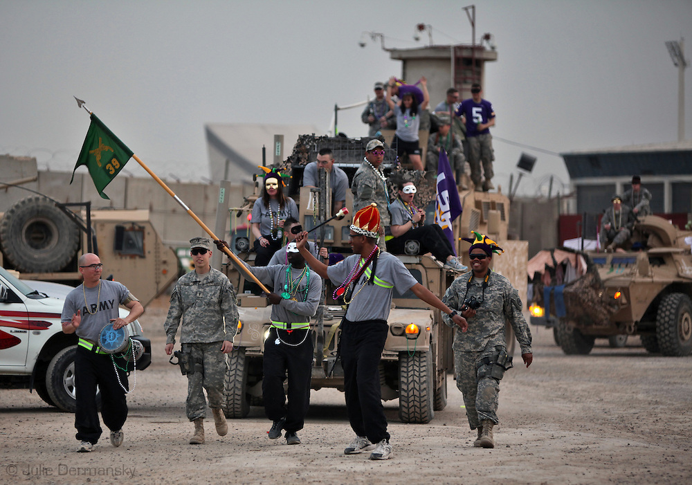 MRAP being used as a float in a Mardi Gra parade held on camp shield -The Louisiana National Guard 39th MP Company held the first ever Mardi Gra parade in Iraq on Camp Shield in Baghdad. Beads shipped in from New Orleans a were thrown to onlookers on the base including security guards from Uganda, and members from other units. The king cakes shipped from New Orleans didn't arrive in time for the holiday but the mess hall cooks made their version of gumbo for the gathering after the parade.