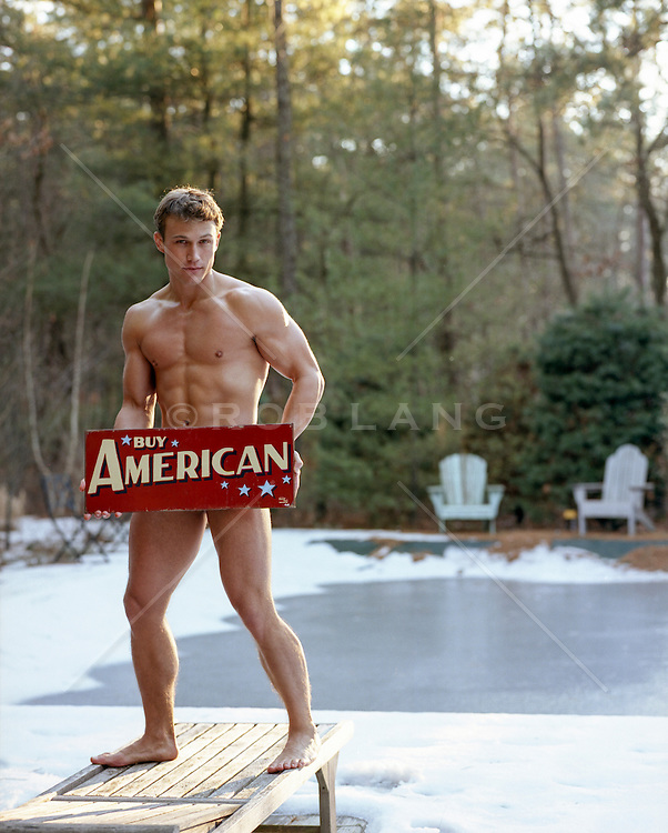 naked All American man holding a sign in front of his body outside in the Winter
