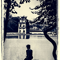 A lonely boy at the central Hoan Kiem lake in Hanoi