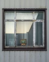 A small painting in window. Vestmannaeyjar islands, Iceland.
