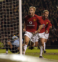 Photo. Jed Wee.<br /> Manchester United v FC Porto, UEFA Champions League, Old Trafford, Manchester. 09/03/2004.<br /> Manchester United's Paul Scholes (L) celebrates his goal with Nicky Butt.