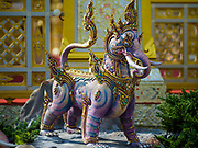 "13 DECEMBER 2017 - BANGKOK, THAILAND:  A statue of ""Thak Tho"" a mythical beast with the body of a lion and the tusks of an elephant, at the Royal Crematorium on Sanam Luang in Bangkok. The crematorium was used for the funeral of Bhumibol Adulyadej, the Late King of Thailand. He was cremated on 26 October 2017. The crematorium is open to visitors until 31 December 2017. It will be torn down early in 2018. More than 3 million people have visited the crematorium since it opened to the public after the cremation of the King.    PHOTO BY JACK KURTZ"