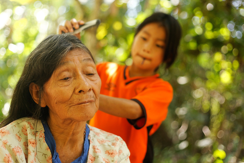 A girl combes her grandmother's hair near San Pedro Sumino in August of 2009.