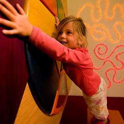 A young girl plays at a music exhibit at the Childrens' Museum of New Hampshire in Dover, New Hampshire.