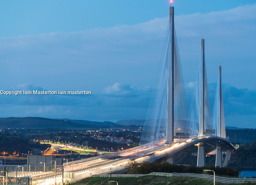 Evening view of new Queensferry Crossing at dusk with traffic crossing  in Scotland, United Kingdom