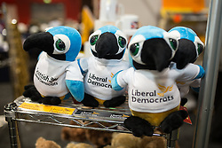 © Licensed to London News Pictures . 14/03/2015 . Liverpool , UK . Liberal Democrats stuffed parrot toys for sale at the exhibition at the conference . The Liberal Democrat Party Conference at the Arena and Conference Centre in Liverpool . Photo credit : Joel Goodman/LNP