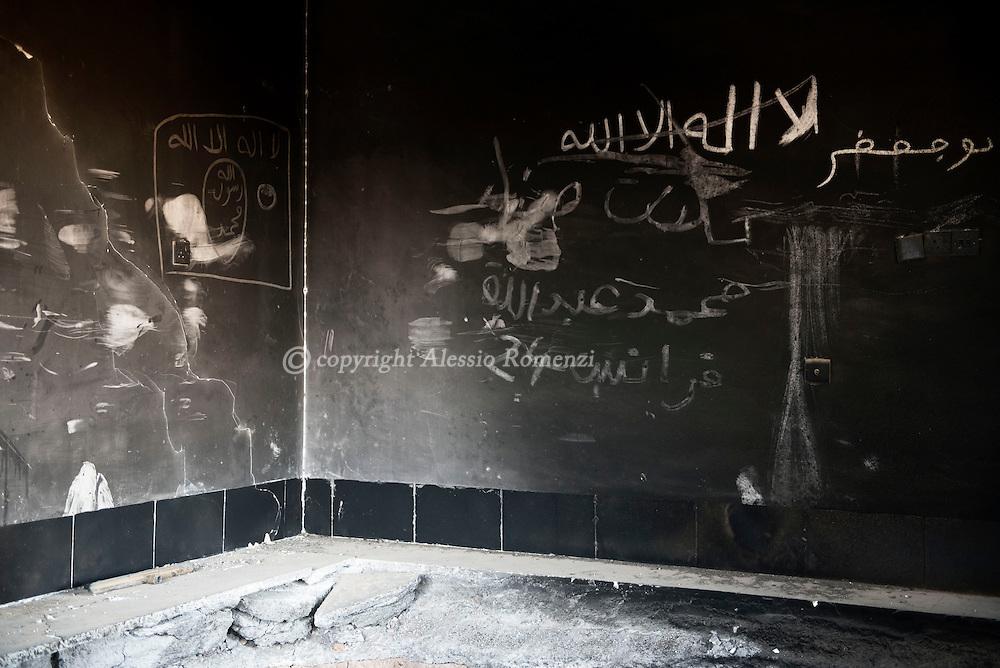 Iraq, Cartella: ISIS writings inside a house used as base in Cartella village. Alessio Romenzi