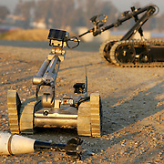 28 DECEMBER 2004.Mosul, Iraq.EOD Robots...In Mosul, Northern Iraq on 28 December US Forces demonstrate their high tech weapons in the form of robots use to examine and destroy Improvised Explosive Devices (IED's) which continue to cause the highest level of casualties throughout the country..The US EOD (Explosive Ordanance Disposal) personnel work in two man teams and have variety of remote control equipment which they can deploy from a distance againt a suspected device. The robots are fitted with cameras and lights or night vision. They can be used to move ordanance or place a charge that will trigger the explosives...Robot shown is a 'TALON' made by Boston Miller Inc...EOD team member is SSG Prather of the 705 EOD unit based at Forward Operating Base (FOB) 'Marez' in Mosul.